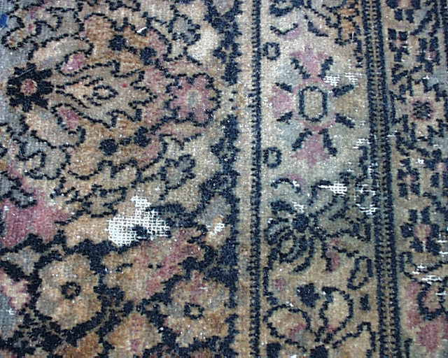 Areas of a Wilton rug where the wool has been eaten away.